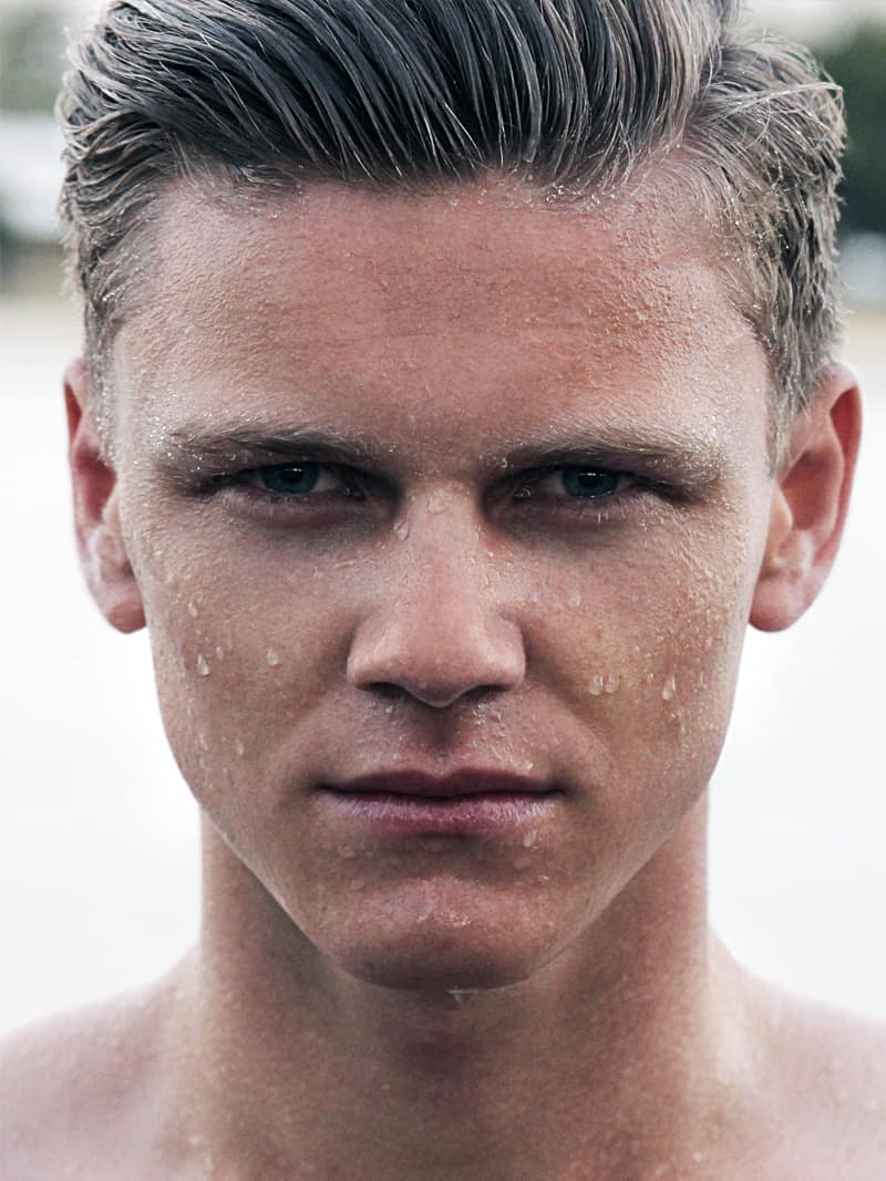 young man with wet face, how to build a solid men's skincare regime